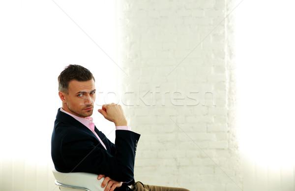 красивый бизнесмен сидят офисные кресла стороны лице Сток-фото © deandrobot