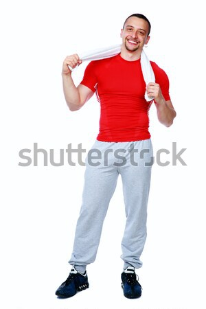 Smiling man drying hair after sport fitness over white background Stock photo © deandrobot