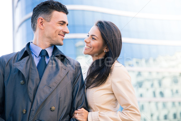 Happy woman and man flirting outdoors Stock photo © deandrobot