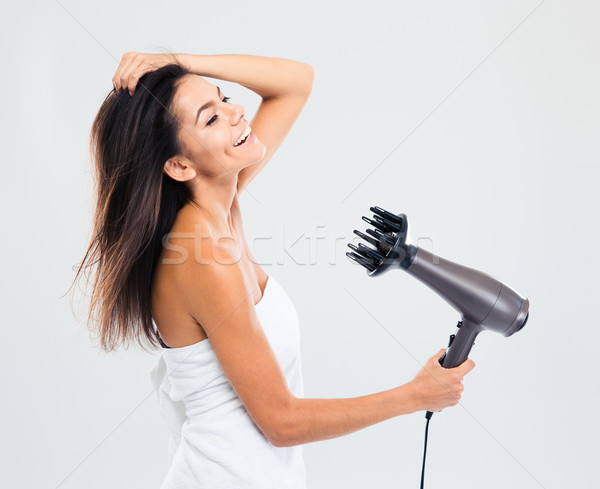 Cheerful woman in towel drying her hair Stock photo © deandrobot