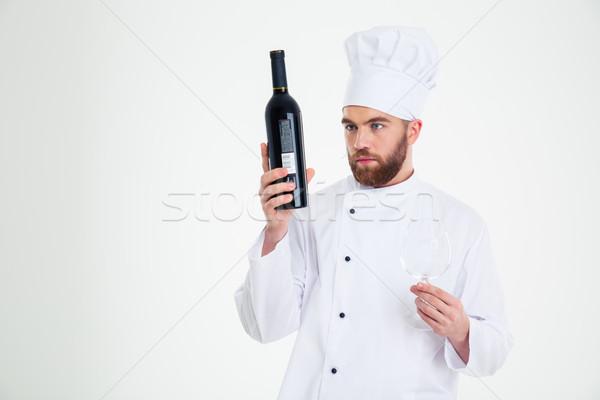 Erkek şef pişirmek şişe şarap Stok fotoğraf © deandrobot