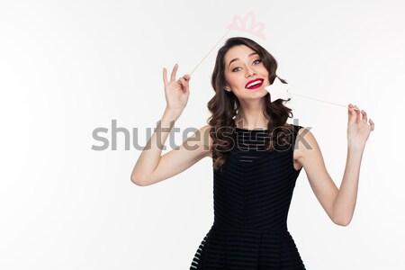 Beautiful girl pointing finger on dollar bills Stock photo © deandrobot