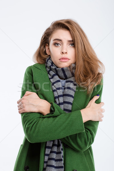 Woman in coat and scarf freezing Stock photo © deandrobot