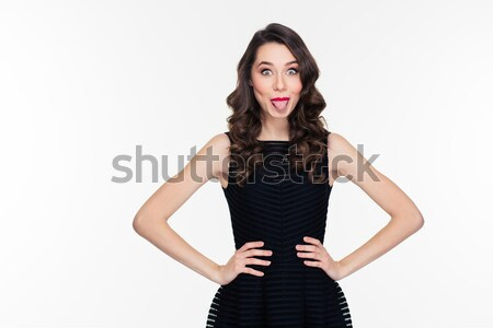 Funny lovely retro styled girl in black dress showing tongue Stock photo © deandrobot