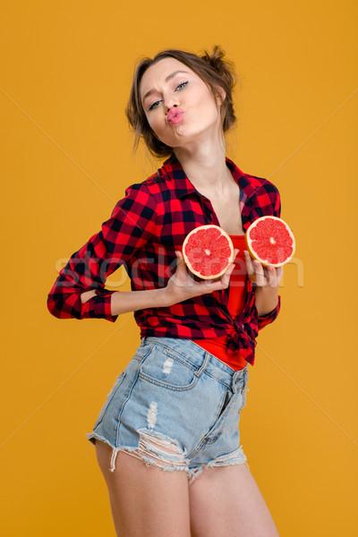 Vicces játékos nő szórakozás kettő grapefruit Stock fotó © deandrobot