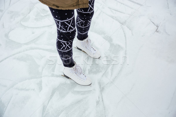 Female legs in ice skates Stock photo © deandrobot