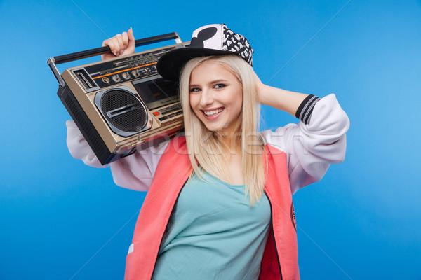 Female teenager holding boom box  Stock photo © deandrobot