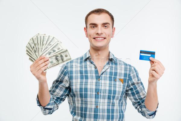Souriant séduisant jeune homme trésorerie carte de crédit Photo stock © deandrobot