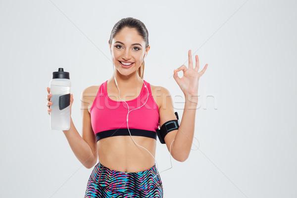Nő tart shaker víz mutat ok Stock fotó © deandrobot