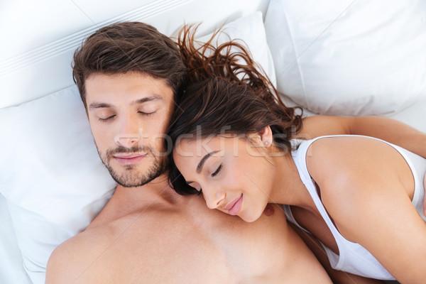 Portret paar slapen bed mooie Stockfoto © deandrobot