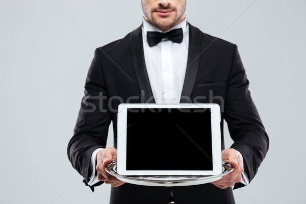 Képernyő tabletta tálca pincér csokornyakkendő közelkép Stock fotó © deandrobot