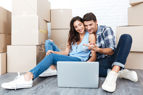 Smiling couple ready to move out Stock photo © deandrobot