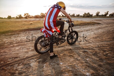 Cropped image of a man wearing american cape on motocycle Stock photo © deandrobot