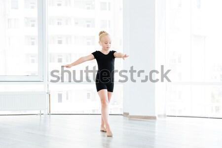 Woman ballerina dancing gracefully in dance studio Stock photo © deandrobot
