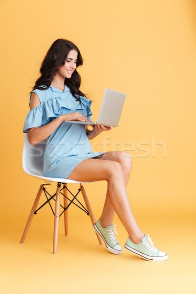 Smart beautiful young girl using laptop pc computer Stock photo © deandrobot