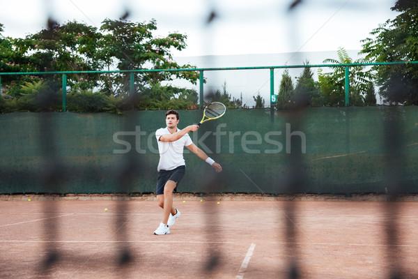Tennis player man Stock photo © deandrobot