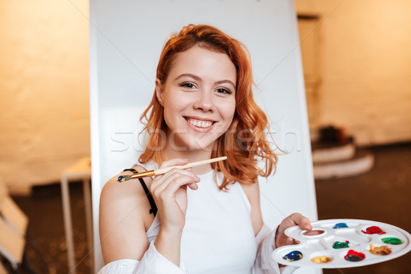 Boldog nő festő áll vászon kép Stock fotó © deandrobot