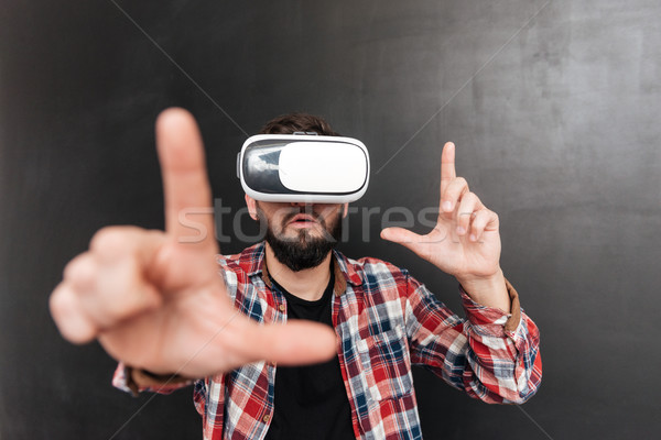 Man wearing virtual reality device standing over chalkboard Stock photo © deandrobot