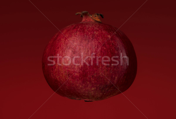 Ripe pomegranate isolated Stock photo © deandrobot