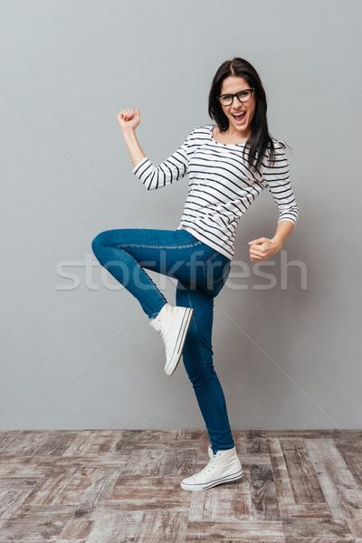 Сток-фото: счастливым · победителем · жест · серый