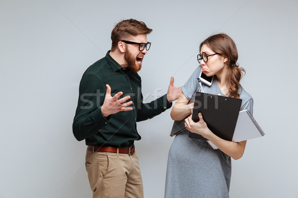 Barbudo homem gritando feminino nerd laptop Foto stock © deandrobot