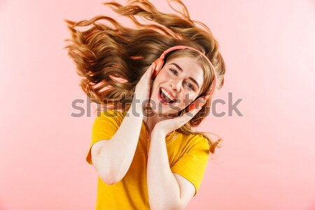 Gorgeous blonde young woman posing with eyes closed Stock photo © deandrobot