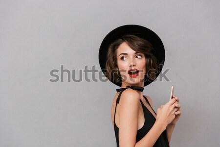 Mulher braço bochecha olhando câmera Foto stock © deandrobot