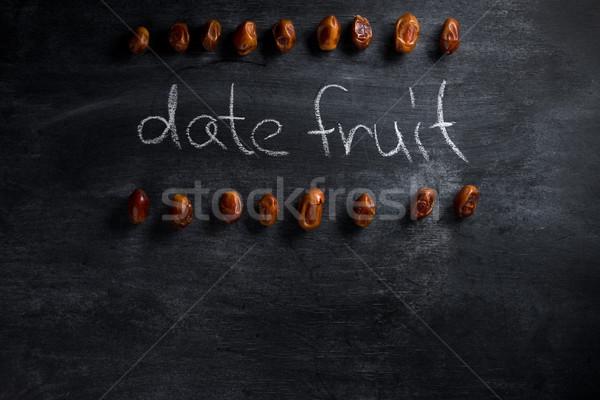 Randevú gyümölcs sötét tábla felső kilátás Stock fotó © deandrobot