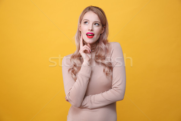 Thoughtful young blonde lady with bright makeup lips Stock photo © deandrobot