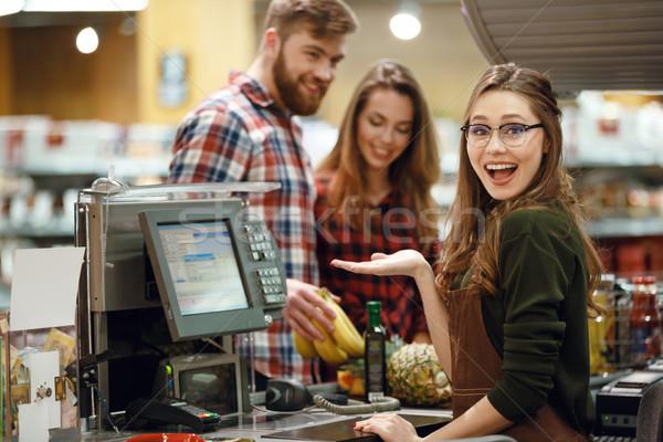 Pénztáros nő munkaterület áruház bolt kép Stock fotó © deandrobot