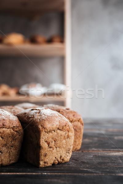 Ekmek un karanlık ahşap masa fotoğraf fırın Stok fotoğraf © deandrobot