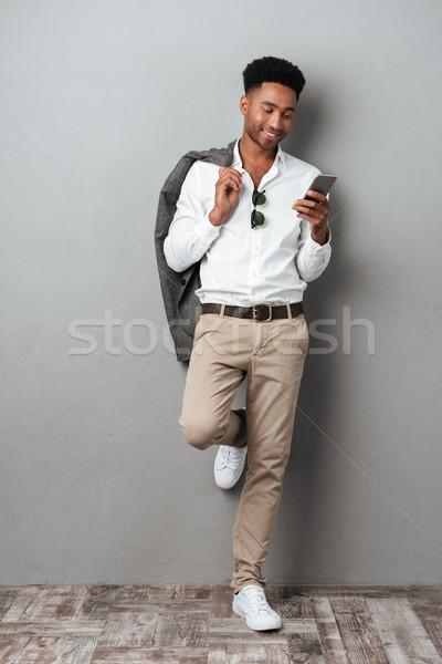 幸せ アフリカ 男 ジャケット 肩 ストックフォト © deandrobot