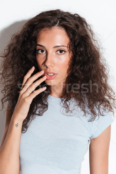 Young woman looking seriously at camera Stock photo © deandrobot