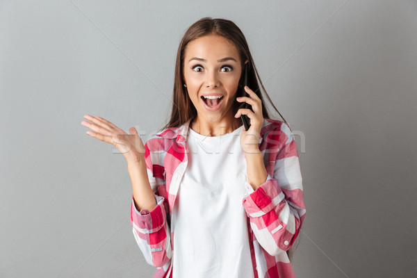 Portré izgatott boldog nő kockás póló Stock fotó © deandrobot
