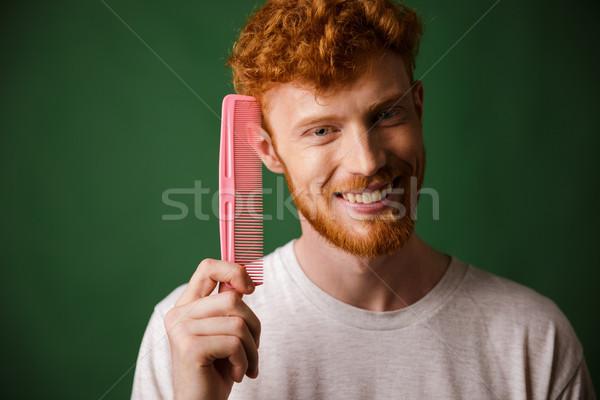 Stockfoto: Glimlachend · jonge · man · tonen · roze · kam