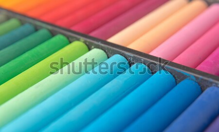 Close-up image of colorful chalk pastels in box Stock photo © deandrobot