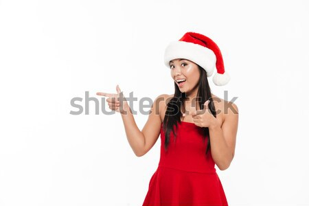 Stock photo: Portrait of a cheerful excited young asian woman