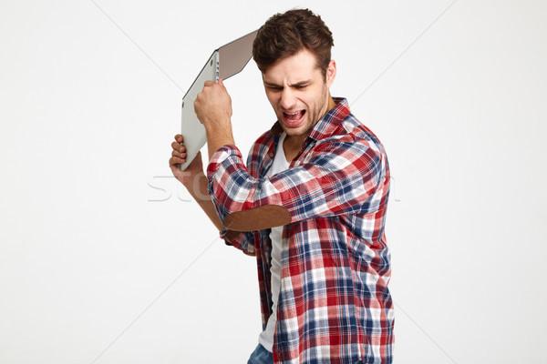 Retrato zangado furioso homem computador portátil Foto stock © deandrobot