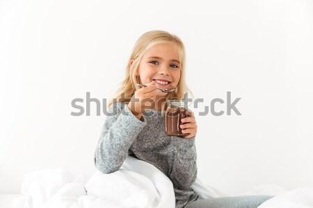Mosolyog kislány tart bank édes csokoládé Stock fotó © deandrobot