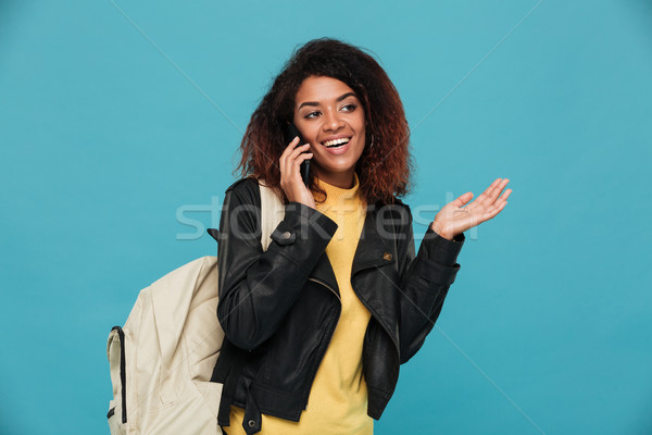 Happy african woman in leather jacket with backpack Stock photo © deandrobot