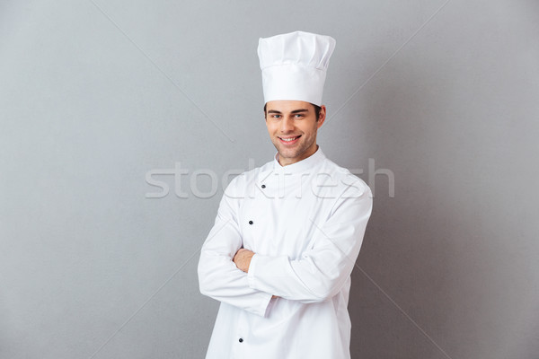 Jeunes Cook uniforme image permanent Photo stock © deandrobot