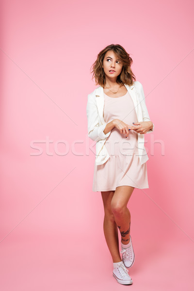 Full length portrait of an embarrassed shy girl Stock photo © deandrobot