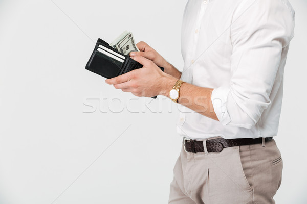 Close up of a man holding wallet full of money Stock photo © deandrobot