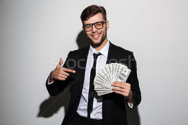 Portrait of a smiling successful man in suit and eyewear Stock photo © deandrobot