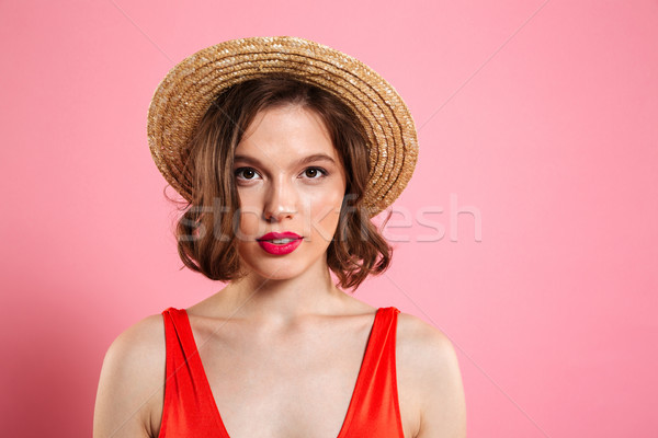 Close up portrait of a pretty young girl wearing make up Stock photo © deandrobot