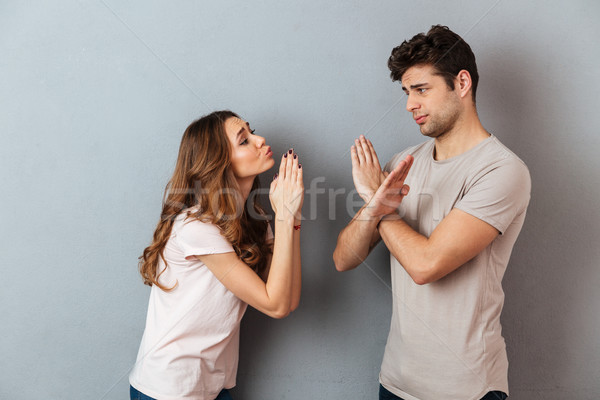 Portrait of a young casual couple standing together Stock photo © deandrobot