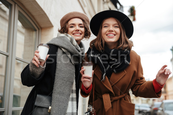 Portrait of two happy girls dressed in autumn clothes Stock photo © deandrobot