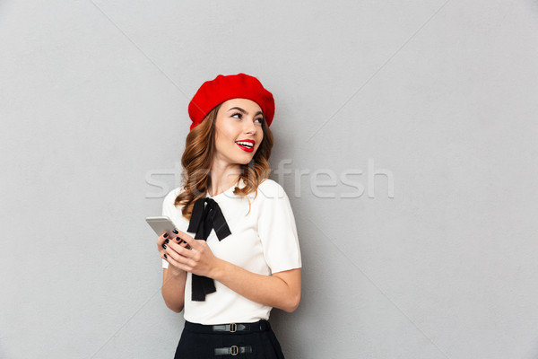 Portrait of a cheery schoolgirl dressed in uniform Stock photo © deandrobot