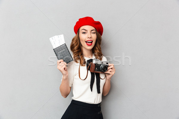 Portrait of a delighted schoolgirl dressed in uniform Stock photo © deandrobot