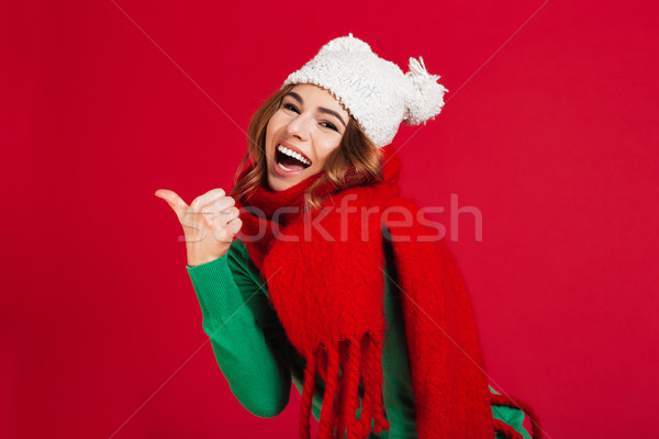 Cheerful brunette woman in sweater, funny hat and scarf Stock photo © deandrobot